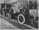 Model-T's coming down a Ford assembly line
