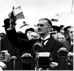 Neville Chamberlain returns with Munich Agreement