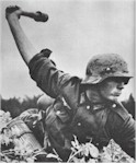 German soldier tosses a grenade at Poles