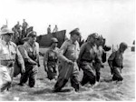 General Douglas MacArthur and staff wade ashore in the Philippines